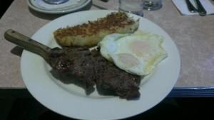 Juicy steak with eggs.