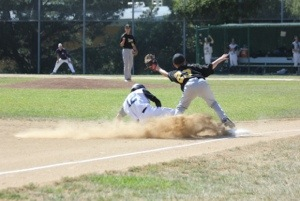 Sophomore Ryan Giberton sliding safely into third