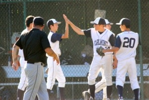 Sophomores Bobby Lyon and Joe Pratt high five after earning a win