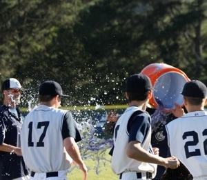 Members of the team celebrate the win by dumping the cooler on head coach Chris Davidson