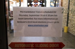 A sign posted on the locked doors of the Belmont Library.