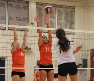 Mia Hogan spikes the ball
