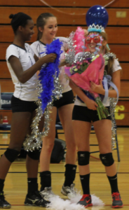 Alexis Morrow and Sabrina Miller shower senior, April Smith with flowers and gifts