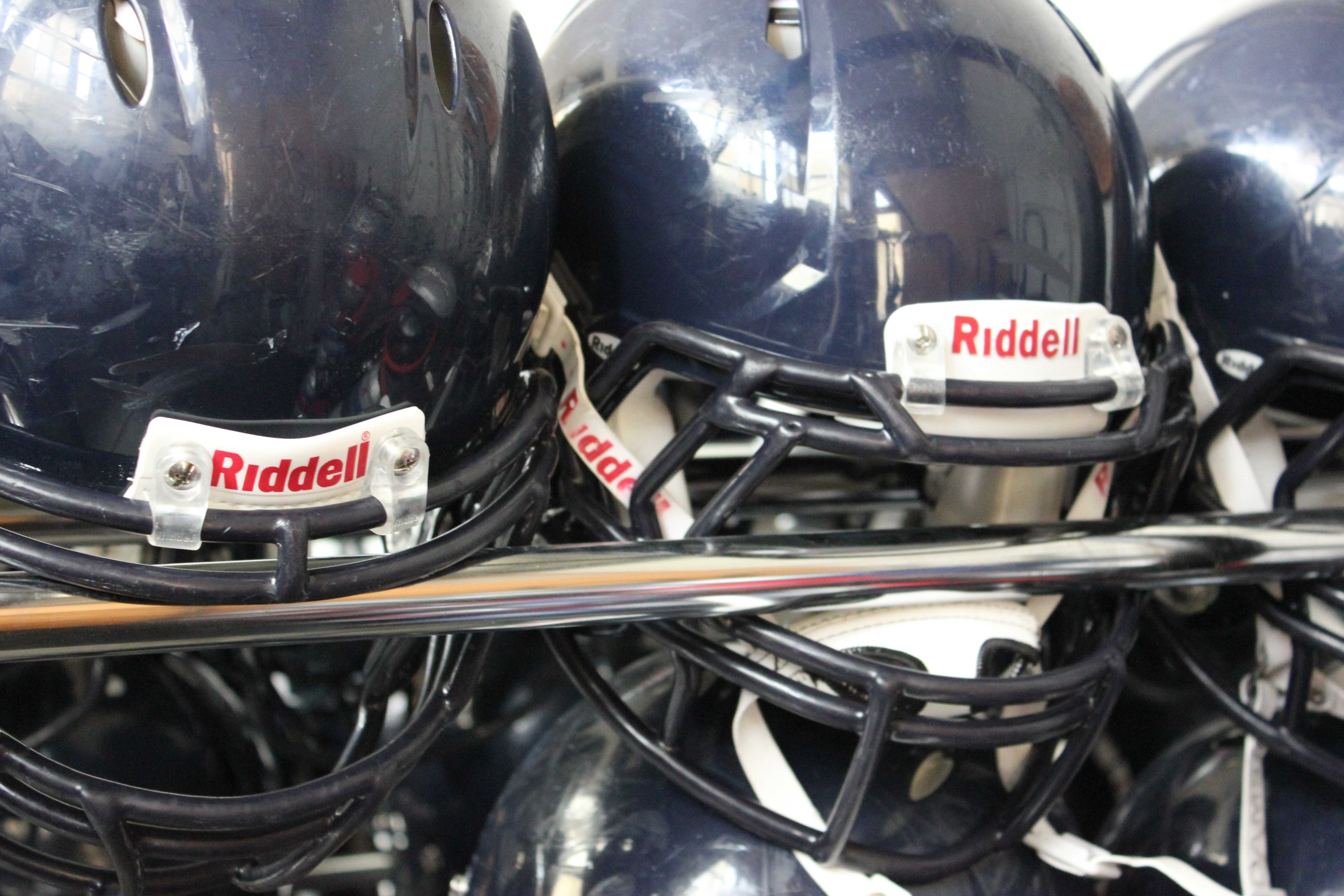 Carlmont's football team wears helmets to decrease the risk of concussions.