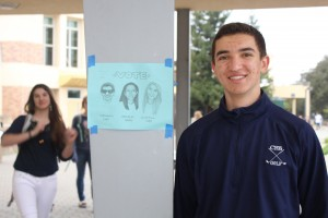 ASB member and Junior Vice President poses next to one of his campaign flyers, anxious to see the results of the upcoming election.