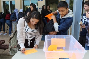 Juniors Kira Roman and Jared Gutierrez carefully decide who to vote for before turning in their ballot.