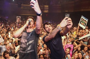"The Chainsmokers take a selfie while performing their hit song ""#SELFIE."""