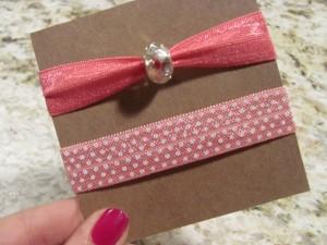 Pink soft elastic hair ties, one with polka dot print