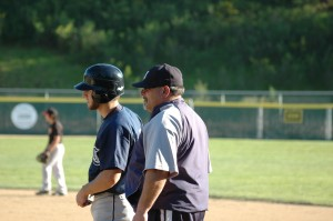 Coach talking with Justin Fink on first base