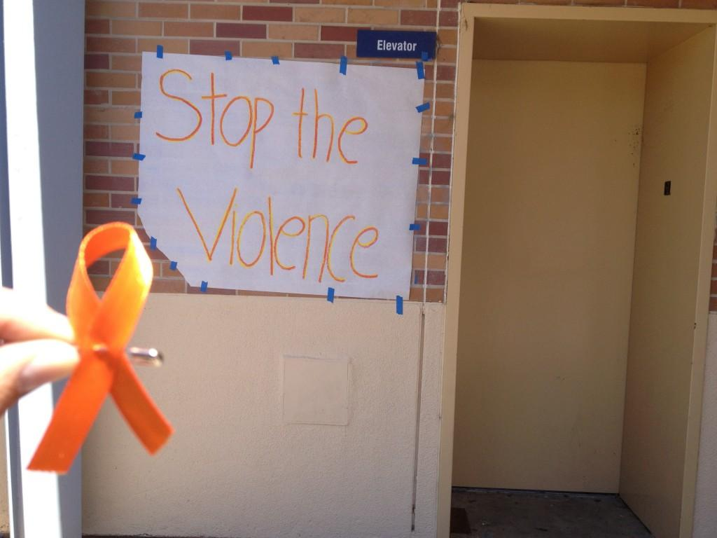 Posters were hung up and orange ribbons were passed out to support the ending of violence.