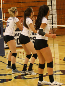 From left to right: Kellan McDonough, Sabrina Miller, and Amelia Tupou prepare to jump for a block