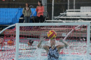Goalie Sina Gomez blocks a shot from Burlingame High School.