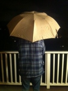 As it begins to rain, umbrellas get raised
