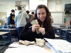 Junior Leah Roe counts the money submitted for second semester members.
