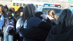 Students are escorted from Berrendo Middle School following the shooting, Tuesday, Jan. 14, 2014.