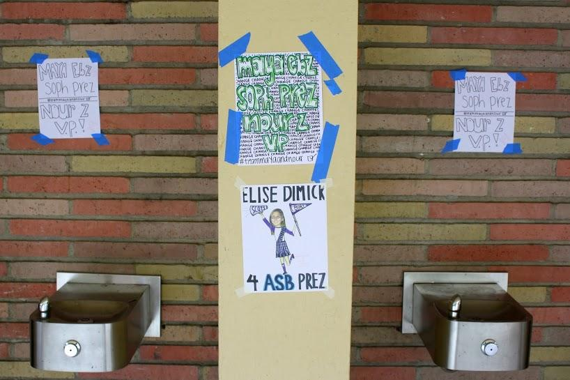 Maya Ebrahimpour and Nour Zabaneh, freshman, promote alongside junior Elise Dimick at the C hall water fountains.