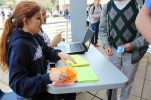 Associated Student Body (ASB) members, Claire Porter and Kristen Friis checked students' IDs to determine which ballot they would receive.