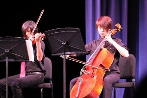 Sophomore Teyva Chee (left) and junior Caitlin Tsai (right) play together in the first of three string quartets.