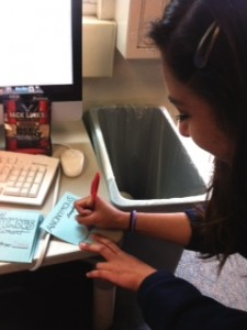 Carlmont student Cheyenne Torres writes an anonymous compliment to a classmate